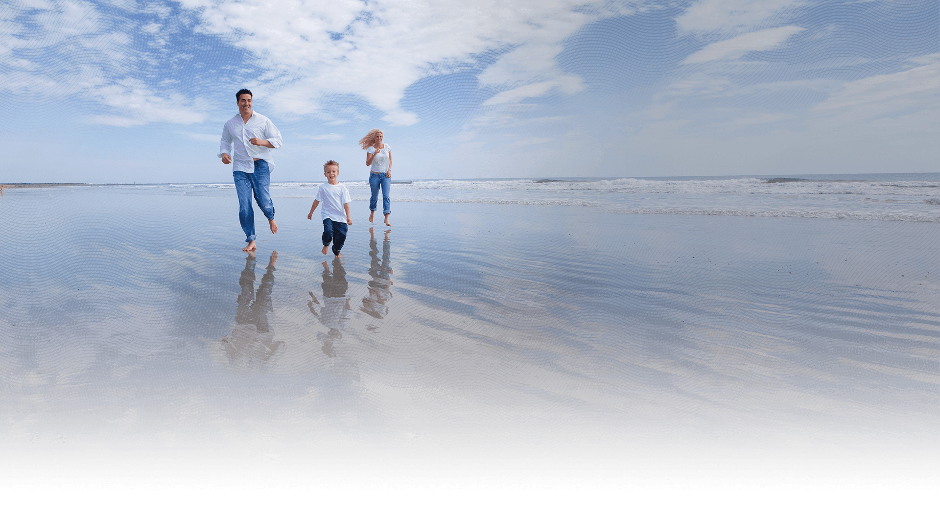 Family runs along the shoreline